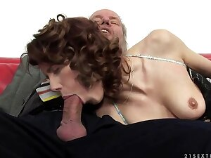 A cute redhead fingers an old man's pain in the neck hole