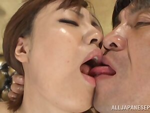 Strange Asian babe drops on her knees to near a sloppy blowjob